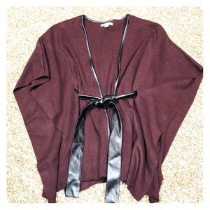 Wrap poncho with leather like belt and trim